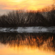 Sunset on the winter river — Stock Photo