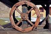 Ancient wooden wheel — Stock Photo