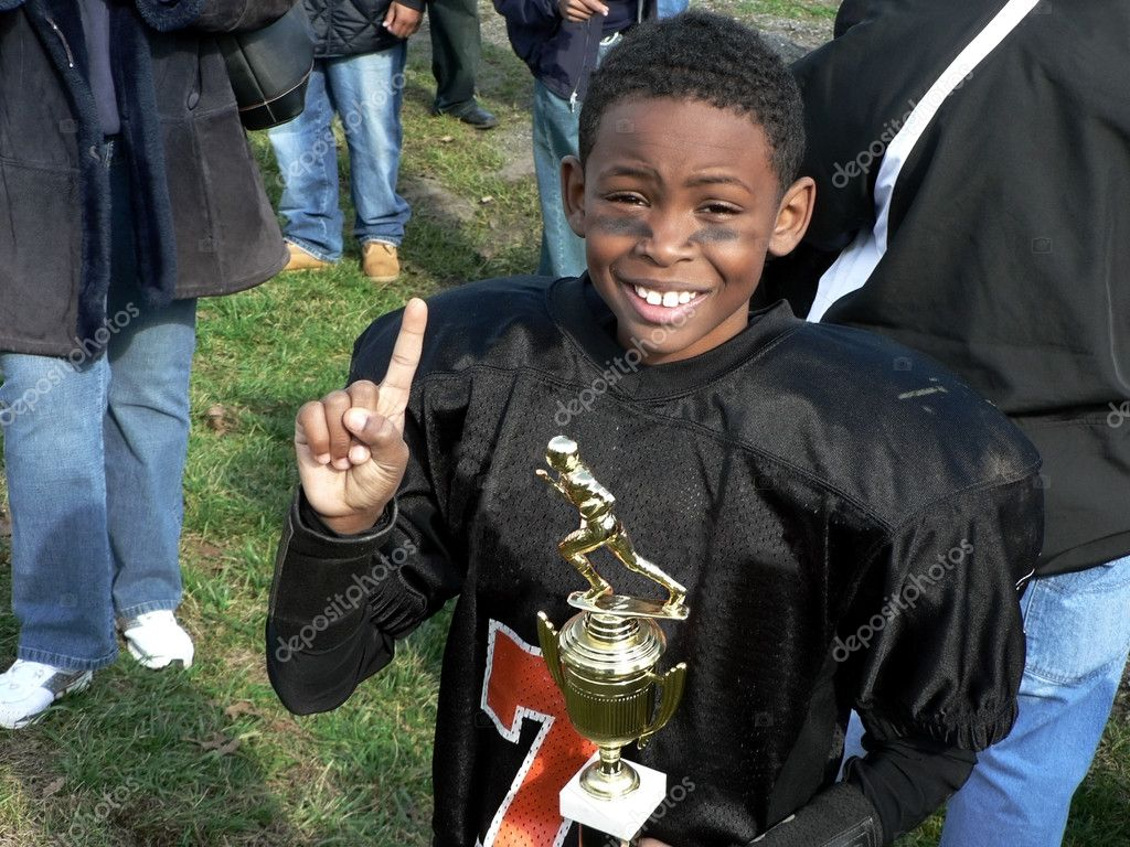 Photo of little league football champion celebrating his victory for the championship — Stock Photo #2191426
