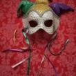 Stock Photo: Carnival mask on fabric 9
