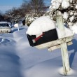 Stock Photo: Snow covered mailbox