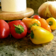 Peppers on kitchen counter 3 - Foto Stock