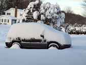 Snow covered vehicle — Stock Photo