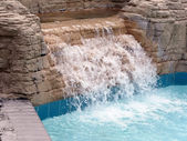 Pool - waterfall in a outdoor pool — Stock Photo