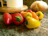 Peppers on kitchen counter 3 — Stock Photo