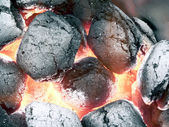 Charcoal - smoldering in flames — Stock Photo