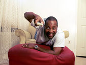 African american man watching tv 2 — Stock Photo