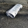 Newspaper - bagged on street curb 2 — Stock Photo