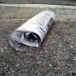 Newspaper - bagged on doorstep 2 — Stock Photo