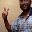 African american man w - peace sign — Stock Photo