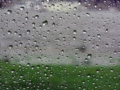 Raindrops on vehicle window — Stock Photo