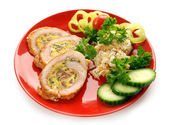 Stuffed turkey meat on red plate — Stock Photo