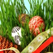 Easter eggs, ribbons and grass - Stock Photo