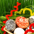 Easter eggs and spring grass - Stock Photo