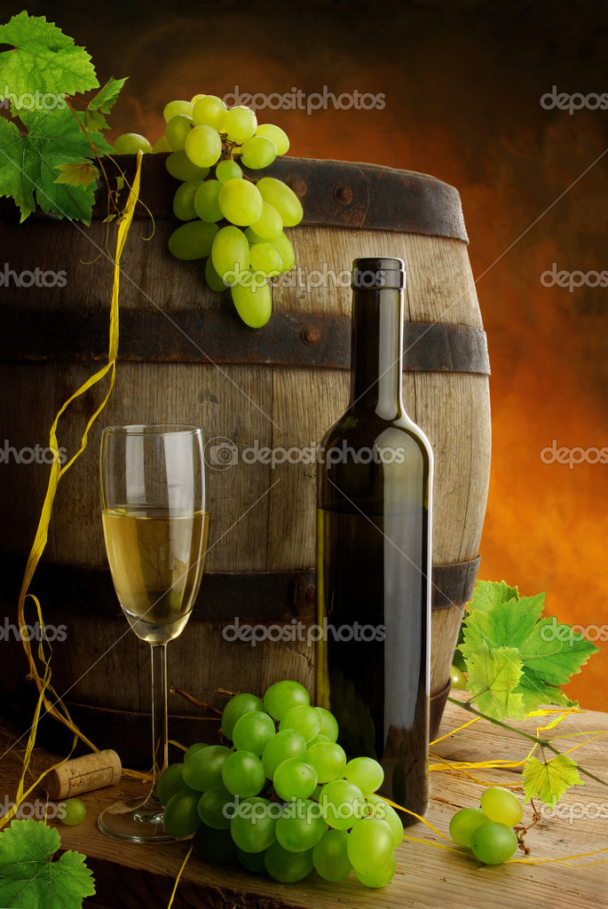 Composition of white wine, grapes, grapevine and wine barrel — Stock Photo #2224402
