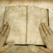 Grunge image of hands on open empty book — Stock Photo #2304401