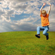 Boy jumping on grass — Foto Stock