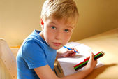 Cute left handed boy — Stock Photo