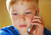 Boy with mobile phone — Stock Photo