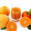 Juice and citrus fruits — Stock Photo
