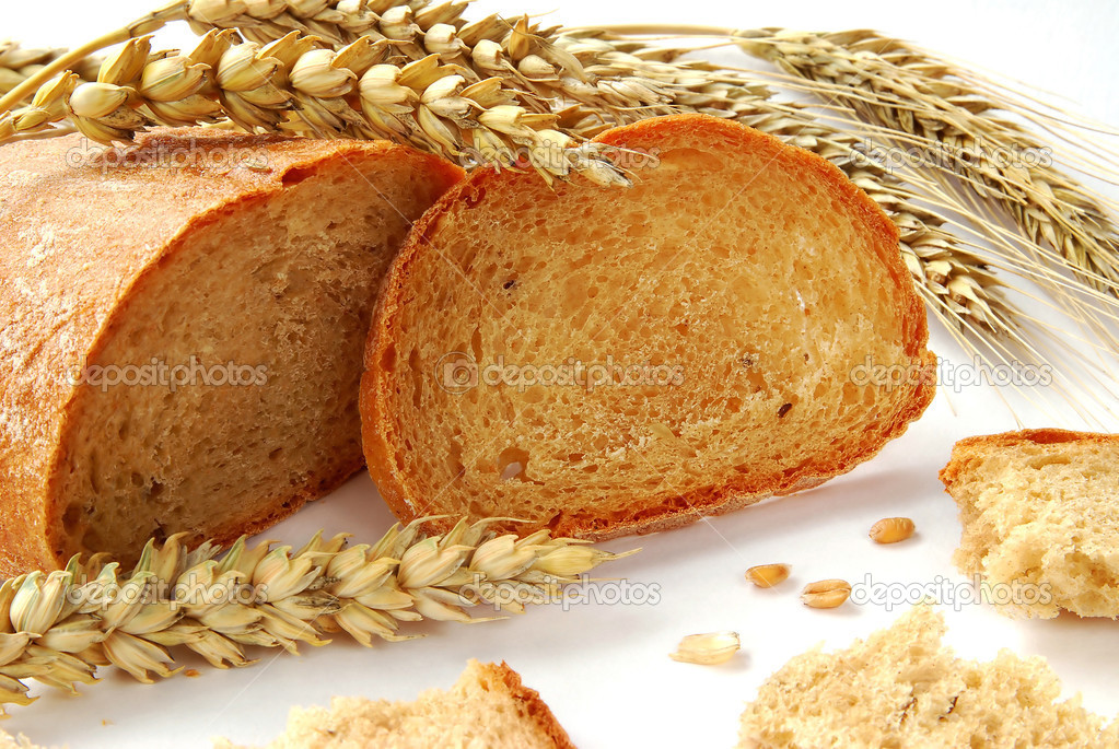 Bread, wheat and grain on white background — Stock Photo #2448936