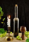 Vintage wine and candlestick — Stock Photo
