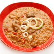 Goulash on red plate — Stock Photo