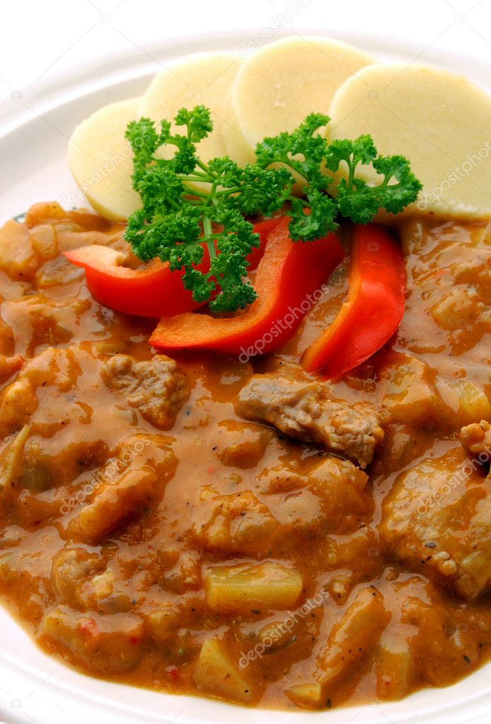 Pork goulash with potato dumplings on white in detail — Stock Photo #2592158