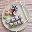 Stock Photo: Sushi rolls, ginger and chopsticks
