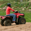 Stock Photo: Women on quad