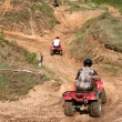 Sportsmen riding quad bikes — Stock Photo