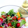 Fresh salad mix and olive oil — Stock Photo