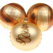 Three golden Christmas baubles — 图库照片