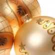 Three golden Christmas baubles — Stok fotoğraf