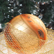 Golden bauble with golden ribbon - Stock Photo