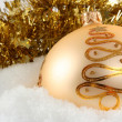 Christmas bauble laying on snow — Stock Photo