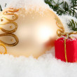 Gold Christmas bauble with red present — Foto Stock