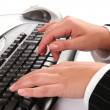 Woman typing on keyboard — Stock Photo