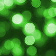 Stock Photo: Glowing green light as background