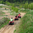 Sportsmen riding quad — Stock Photo