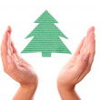 Hand with ecology handmade pine tree - Stock Photo