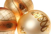 Three golden Christmas baubles — Stock Photo