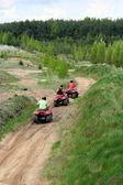 Sportsmen riding quad — Stock Photo