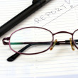 Notepad with eyeglasses and pen — Stock Photo