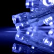 Blue LED lights closeup with reflection — Stock Photo