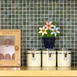 Tidy kitchen worktop with flowers — Stock Photo