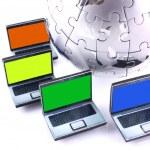 Laptops around a chrome globe — Stock Photo