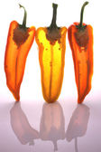 Peppers in half with light through them — Stock Photo