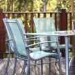 Stock Photo: Chairs on decking in summer light