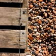 Stock Photo: Decking and pebbles